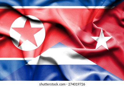 Waving flag of Cuba and North Korea