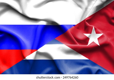 Waving flag of Cuba and Russia