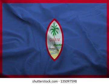 Waving flag of Guam. Flag has real fabric texture.