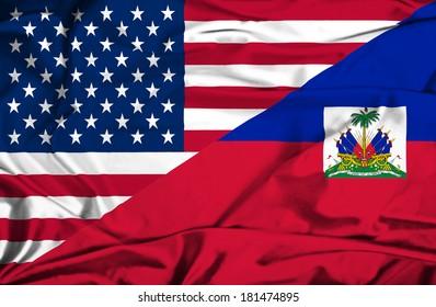Waving flag of Haiti and USA