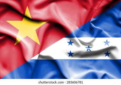 Waving flag of Honduras and Vietnam