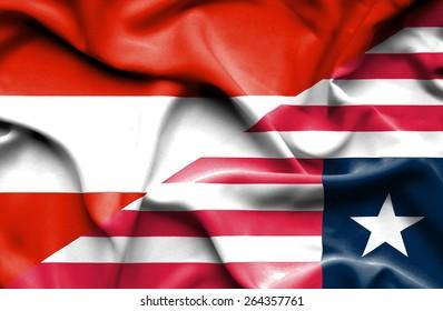 Waving flag of Liberia and Austria