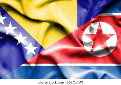 Waving flag of North Korea and Bosnia and Herzegovina