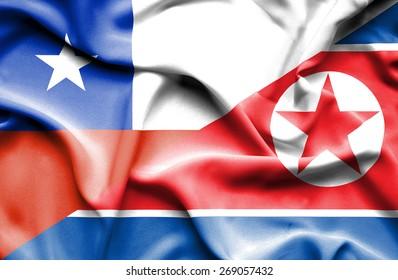 Waving flag of North Korea and Chile