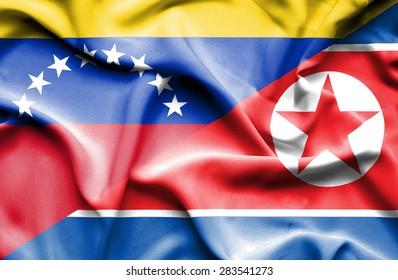 Waving flag of North Korea and Venezuela