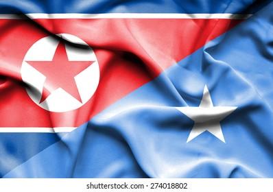 Waving flag of Somalia and North Korea