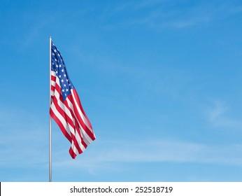 Waving flag of usa on a sky background