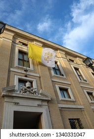 waving flag of the Vatican papal state with the symbol of the two crossed keys above the gate