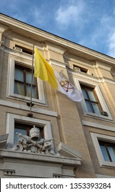 waving flag of the Vatican papal state with the symbol of the two crossed keys