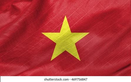 Waving flag of Vietnam. Flag has real fabric texture.