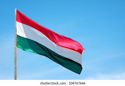 Waving Hungarian Flag Against Blue Sky