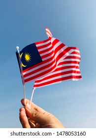 Waving of the Malaysia flags in the sky
