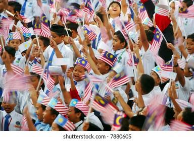 Waving Malaysia's flags.