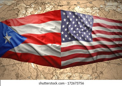 Waving Puerto-Rican and American flags on the of the political map of the world