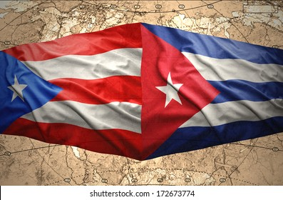 Waving Puerto-Rican and Cuban flags on the of the political map of the world
