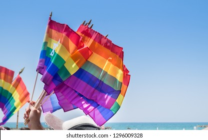 Waving rainbow flags with David Star for sale at annual gay pride parade & festival in Tel-Aviv