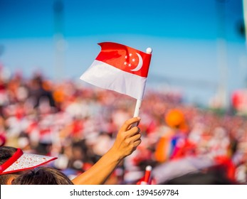 Waving a Singapore Flag during the National Day Parade
