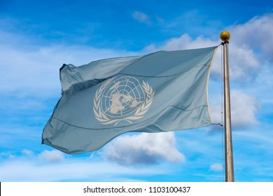 Waving united nations UN flag in the deep blue sky background