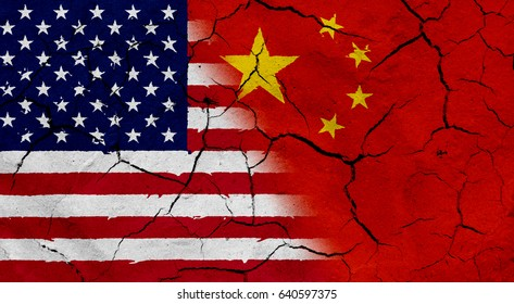 Waving USA and China flag together, with dried soil texture