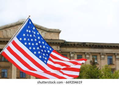 Waving USA flag and beautiful building on background
