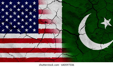Waving USA and Pakistan flag together, with dried soil texture