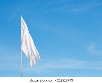Waving white flag  on a sky background