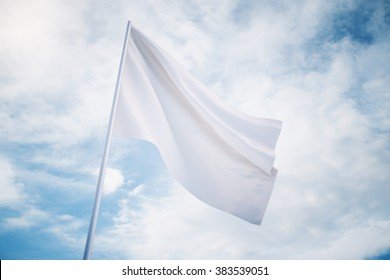 Waving white flag on a sky background, mock up