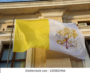 waving yellow and white flag of the Vatican papal state with the symbol of the two crossed keys