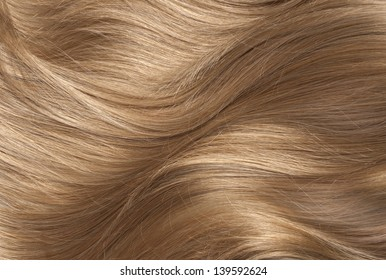 Wavy blonde human hair background