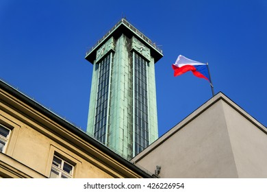 Wavy Czech national flag and Viewing tower of the New Town city hall (Nova radnice), Ostrava, Czech Republic / Czechia. Building is the most recognizable tourist attraction in the town.