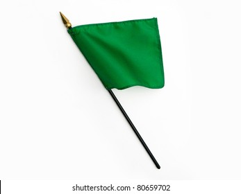 Wavy Green Silk Flag on Pole isolated on white background
