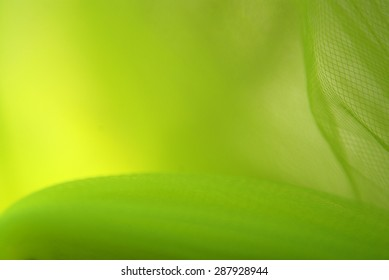 Wavy green and yellow texture and background with checkered pattern