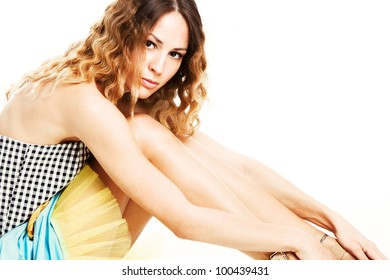 wavy hair young woman  in summer dress studio shot