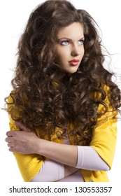 wavy haired beauty girl in yellow jacket isolated on white