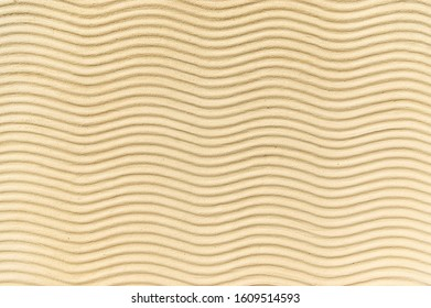 Wavy lines as an ornament from plaster on the outer facade in beige color can also be used as a background, short focal length