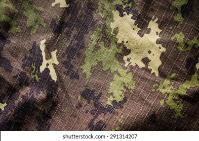 Wavy Military vegetato camouflage rip-stop fabric texture background