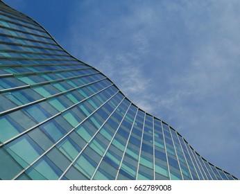 Wavy Mirror Facade Office Building