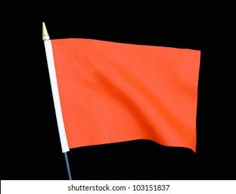 Wavy Orange Flag isolated on black background