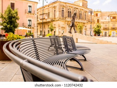 A wavy seat in the middle of a town square, in Grammichele, Sicily, Italy.