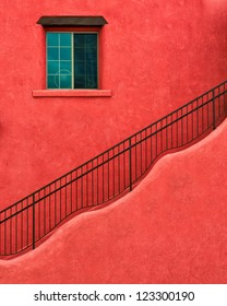 Wavy stairs on adobe red building