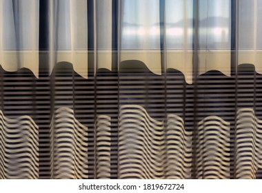 A wavy striped pattern created by a curtain rendered in an abstract style