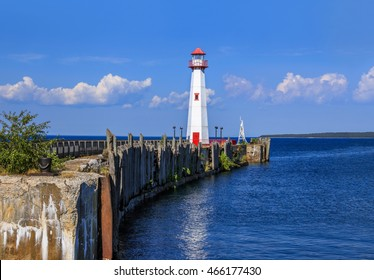 The Wawatam Lighthouse, or St. Ignace Lighthouse as it looks toward Mackinac Island in the Straits of Mackinac on a lazy Summer afternoon, Michigan, Upper Peninsula, USA
