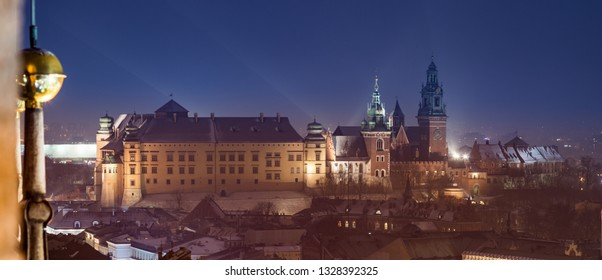 Wawel castle and cathedral over old town roofs night view, Krakow Poland