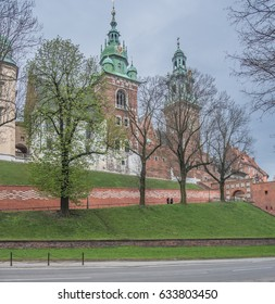Wawel Hill & Royal Wawel Castle, Krakow, Poland-April 15, 2017: The fortified complex as seen from the side of the Old Town of Krakow Podzamche (Under the Castle) street.