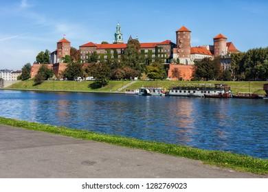 Wawel Royal Castle in city of Krakow in Poland, view across the Vistula river.