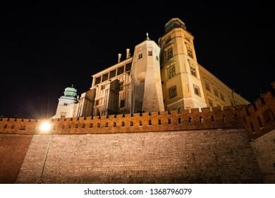 Wawel Royal Castle illuminated at night in city of Krakow, Poland