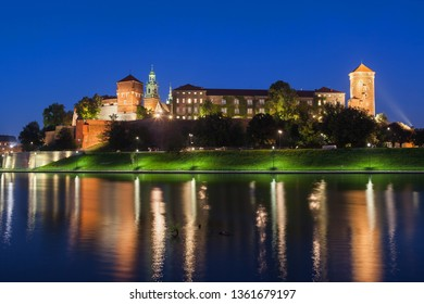 Wawel Royal Castle at night in Krakow, Poland, river view.