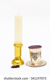 Wax candle with a glass of wine and fragrant cloves. Havdalah.