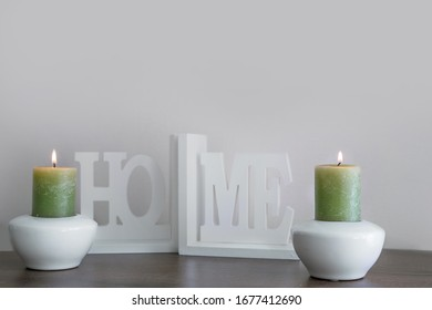 Wax candles, green elements for room design