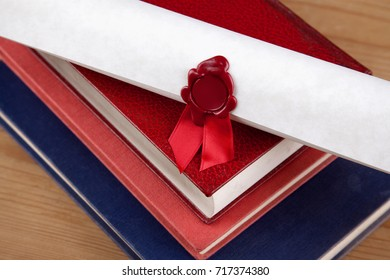 A wax sealed certificate on top of some old books, blank seal with copy space.